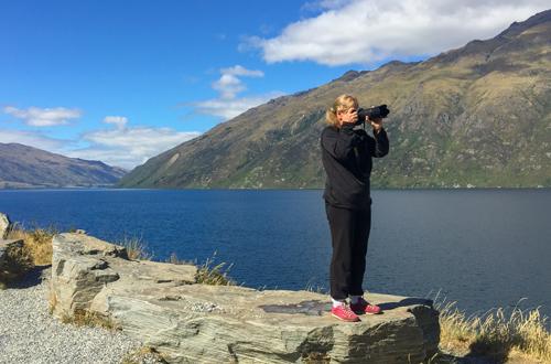 Photographer at Lake Wakatipu in New Zealand