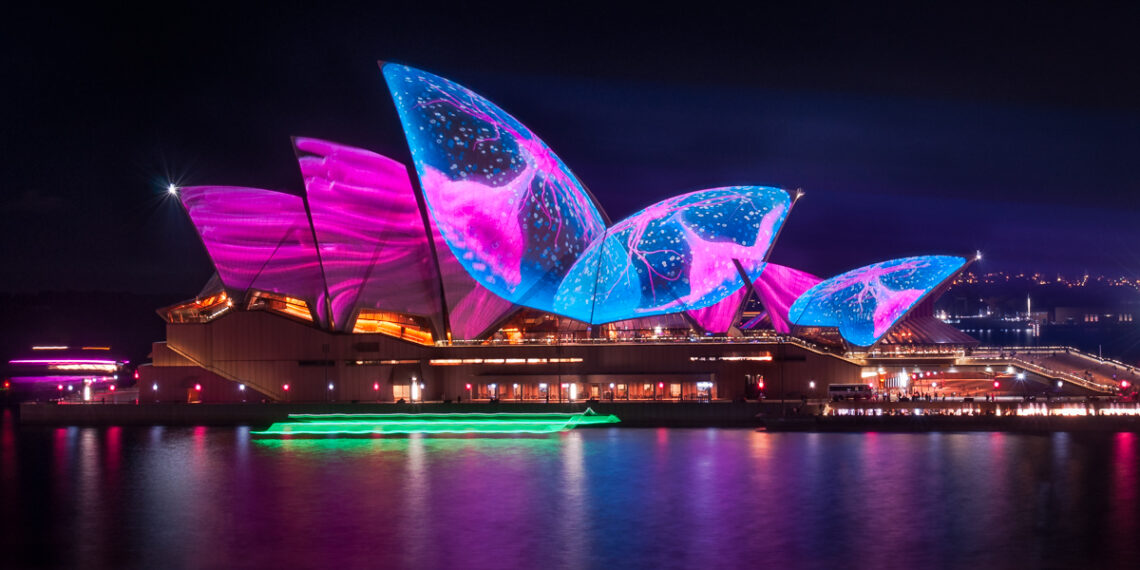Illuminating Opera House's roofs with an art work representing a pulsating sea creature in amazing colors at Vivid Sydney Festival in 2017, in Australia.