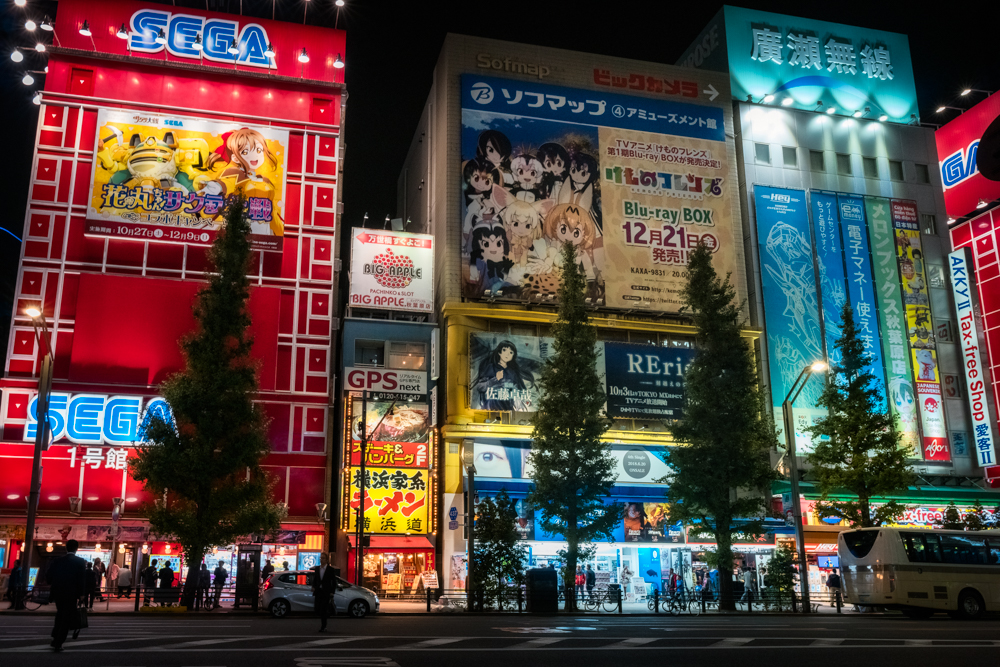 Tokyo scene at night with colourful advertising in Akihabara